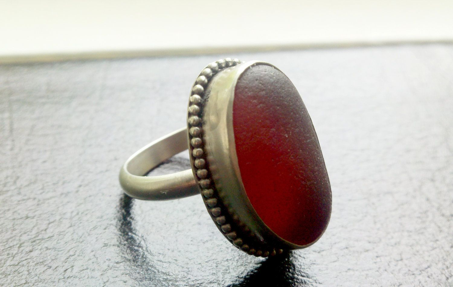 """SALE--SALE---Sea Glass Ring Large Red in Fine Silver and Sterling Silver Beaded Bezel. 25% off with coupon code """"25off"""". $195.00 USD, via Etsy."""