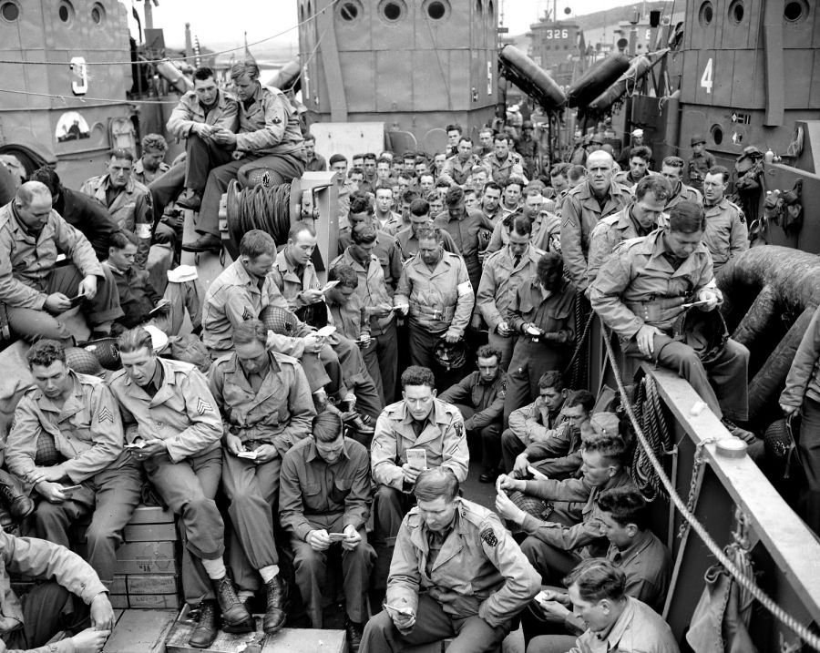 U.S. serviceman attend a Protestant service aboard a landing craft before the D-Day invasion on the coast of France, June 5, 1944.