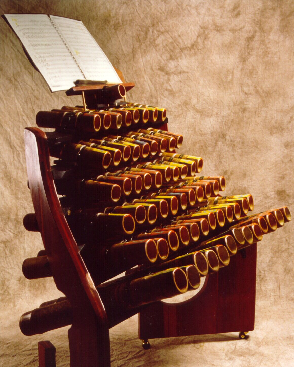 """Harry Partch Instrument - """"Boo II"""" I suppose this counts as wind.. Otherwise known as a Batphone.. The tubes are hit with rubber paddles or something similar, which  shoots air down a tuned length.  See The Blue Man Group"""