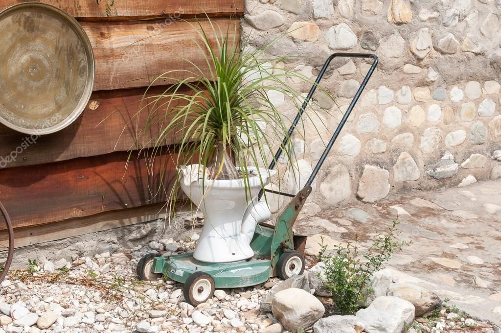Innovative Recycling Of A Lawnmower And Toilet Bowl Stock Photo Ad Lawnmower Recycling Innovative Toilet Ad In 2020 Toilet Bowl Recycling Lawn Mower