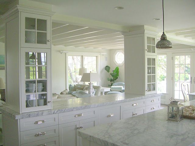 Divider between kitchen and living space. Glass front cabinets are ...