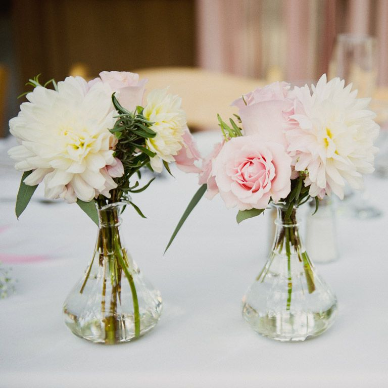 Arrange Multiple Small Flower Arrangements On Tables Rather Than