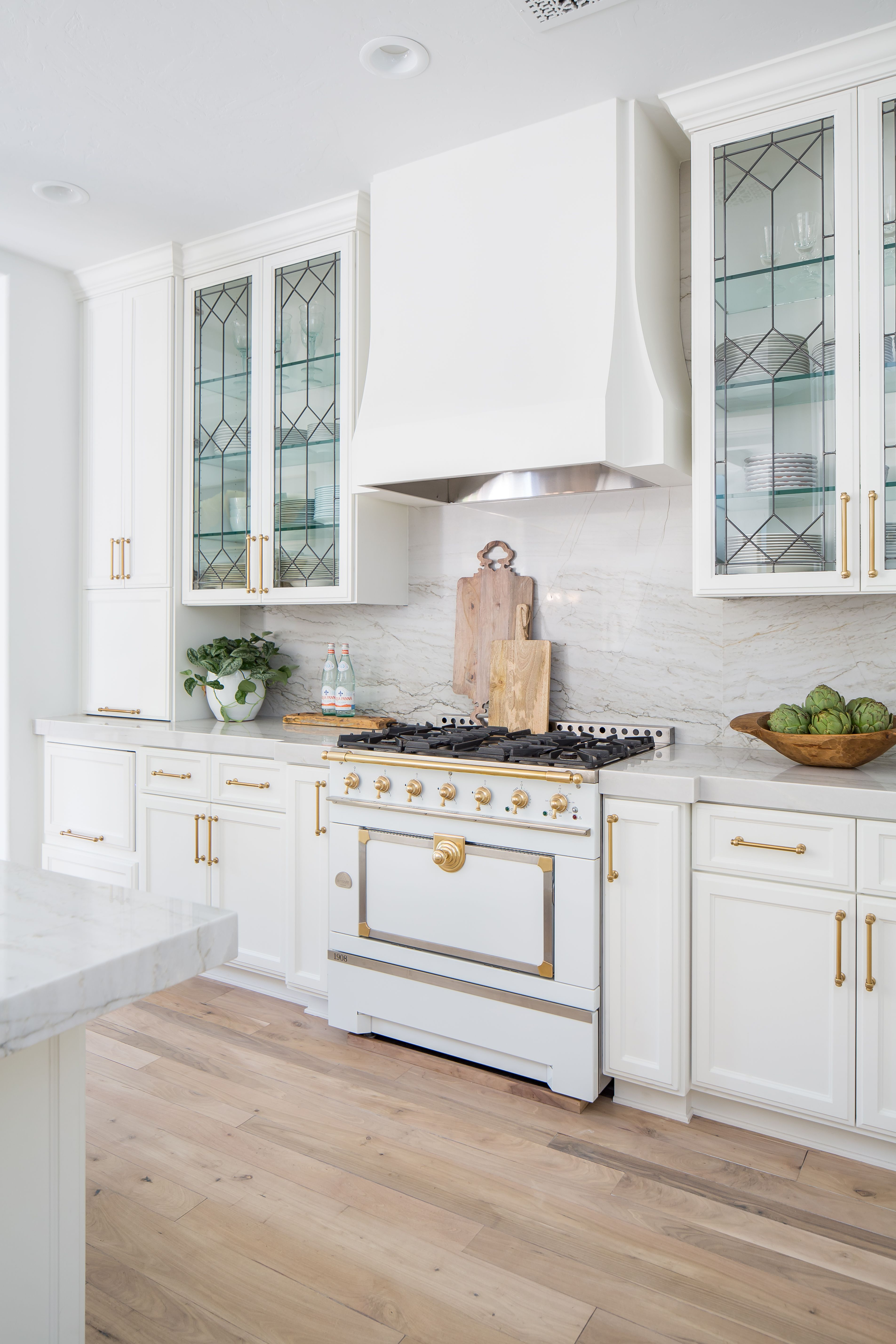 Featuring gold accents, leaded glass and a white La Corue ...