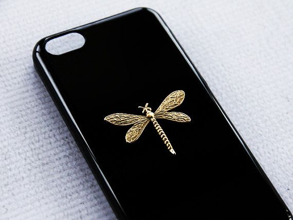 A hand-hammered 22kt gold plated dragonfly pendant laid on our black hard shell case. Handmade to order!