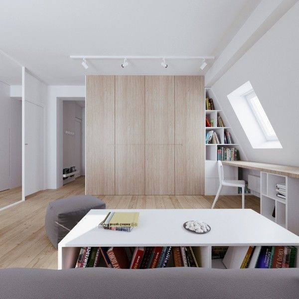 The key to great interior design when it comes to small spaces is being able to use the same space for more than one purpose in this top floor apartment