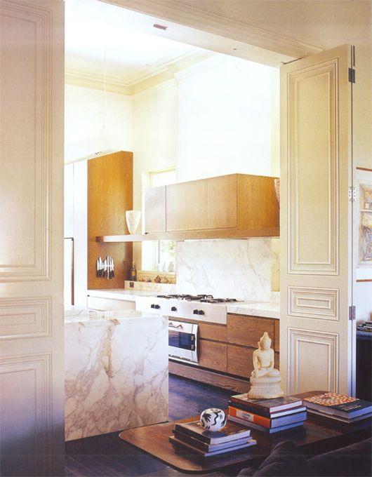 stunning marble kitchen island waterfall amidst period architecture ...