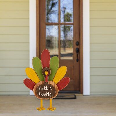 The Holiday Aisle® Its a standing turkey for thanksgiving. The turkey features wooden legs and a colorful tail. It is written