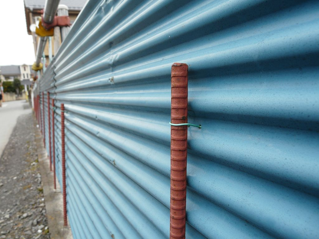 Corrugated Iron Sheets Form A Fence When Affixed To Metal