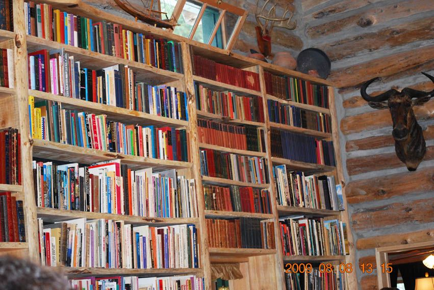 Those book shelves are at least two inches thick and about 15 feet high.