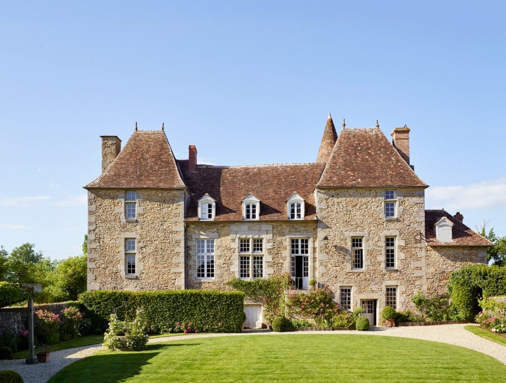 Exterior /  The main façade of the historic Normandy, France, house owned by fashion designer Peter Copping. /      Photographer: Richard Powers     Homeowner: Peter Copping and Rambert Rigaud     Article: French Connection, September 2015     Location: Normandy, France