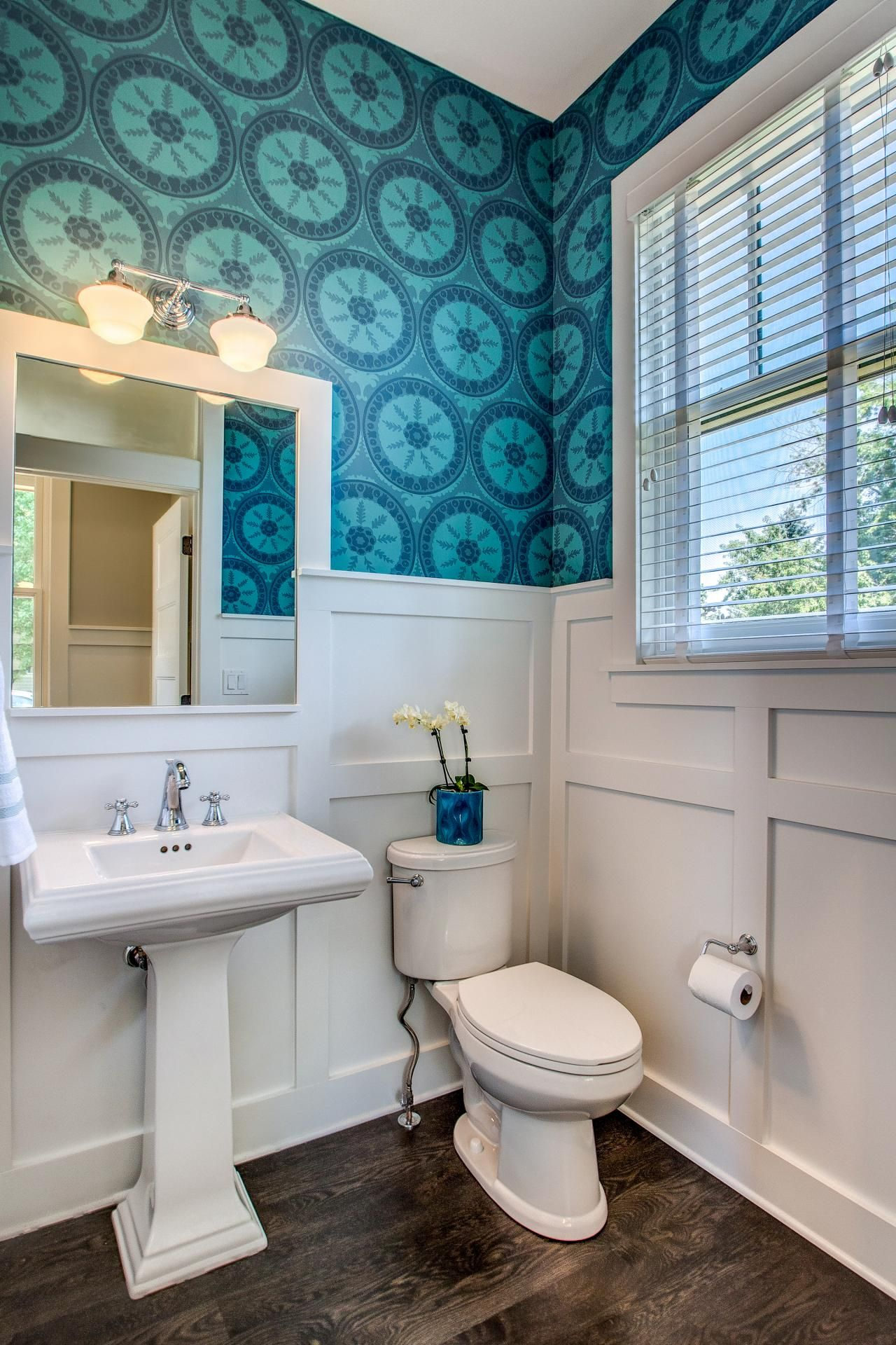 Powder Room With Blue Patterned Wallpaper And White Wainscoting