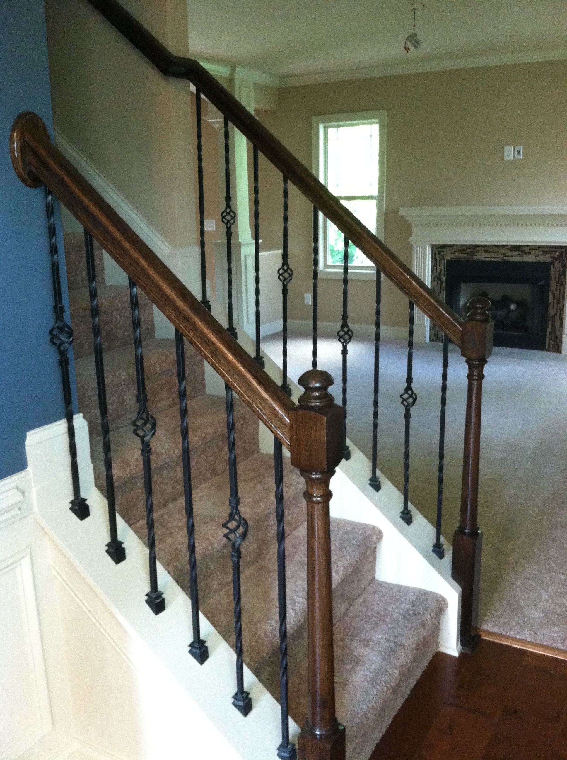 Love my stair rails... Always wanted wrought iron pickets ...