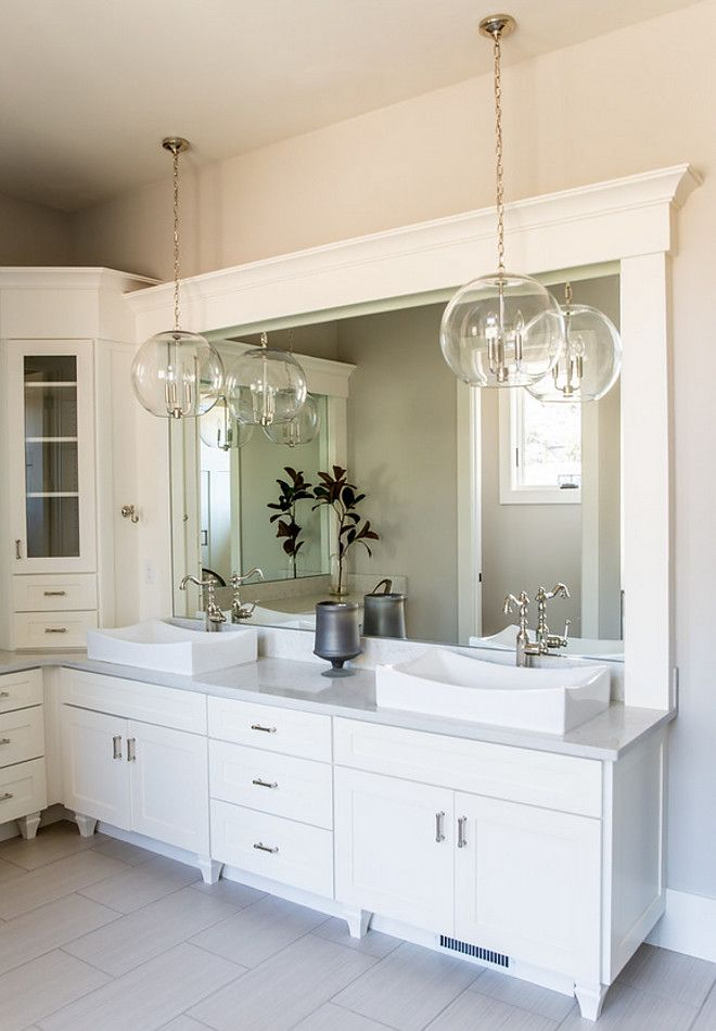 although i like the idea of an led mirror i like these 2 large pendants hanging in front of large vanity mirror and how they sparkle and reflect - Bathroom Pendant Lighting