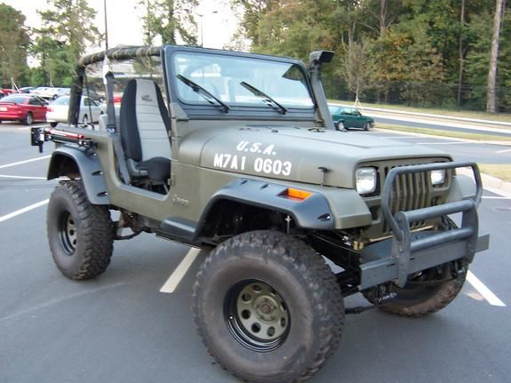 Own An Olive Drab Jeep Wrangler With An Extra Red Gas Tank Jeep