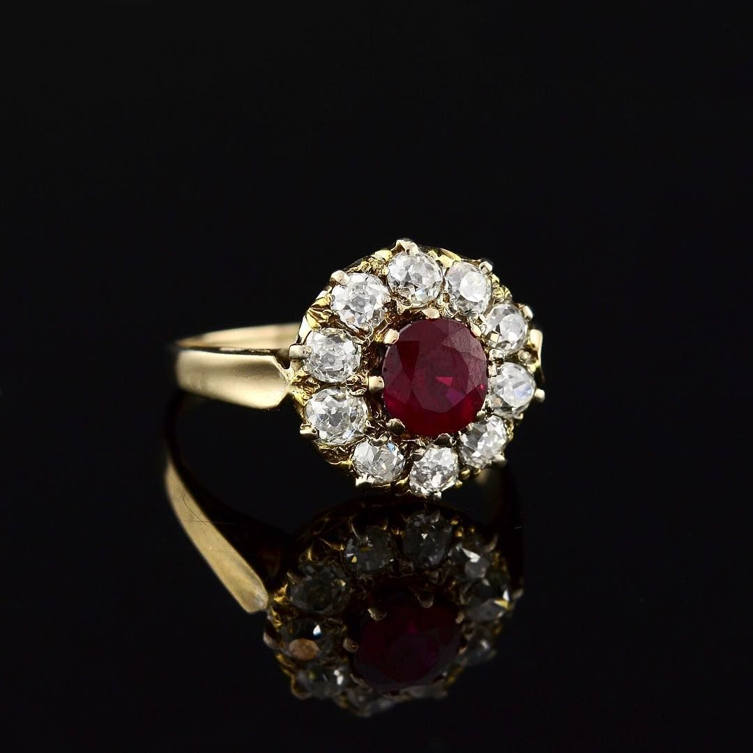 This Victorian beauty holds a beautiful deep red .70ctw ruby at the center of a diamond halo (1.20ctw of Old Mine cut diamonds)! It's a stunning ring that would make a unique and special engagement ring. Will be up on our website soon! abrandtandson.com