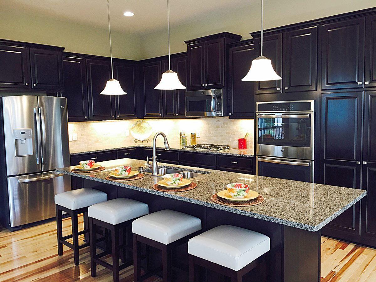 Now These Are The Kind Of Dark Stained Cabinets That Will Make A Kitchen Look Good Drhorton Homes Home Dark Stained Cabinets New Homes