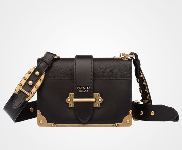 Prada Cahier calf leather bag Leather shoulder strap embellished with  bronze studs Bronze hardware Bronze lettering logo Lace closure on the  front Two ...