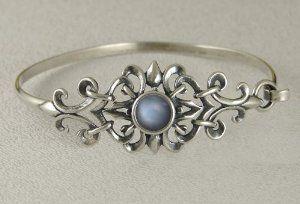 Sterling Silver Filigree Strap Bracelet Accented with Genuine Grey Moonstone Silver Dragon-Bracelets. $68.00