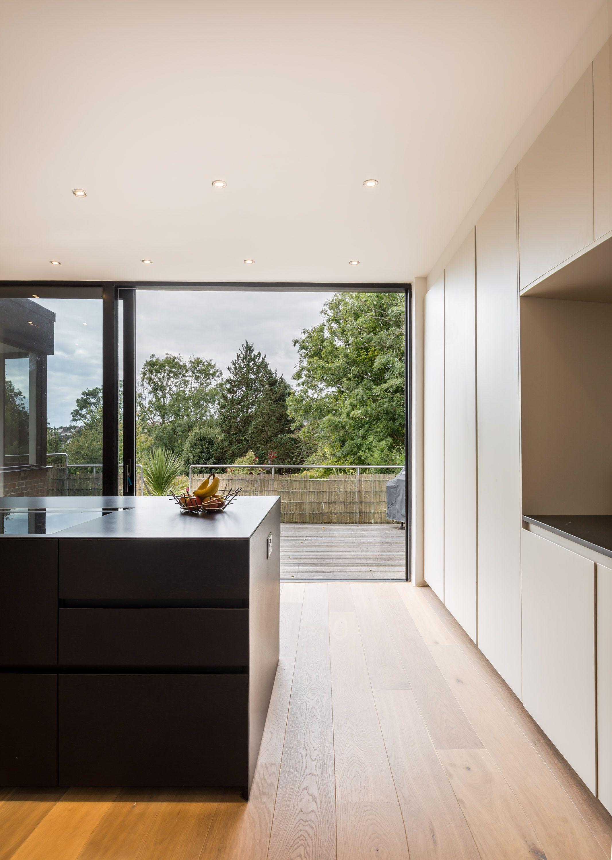 Contemporary kitchen black and white colour scheme sleek units
