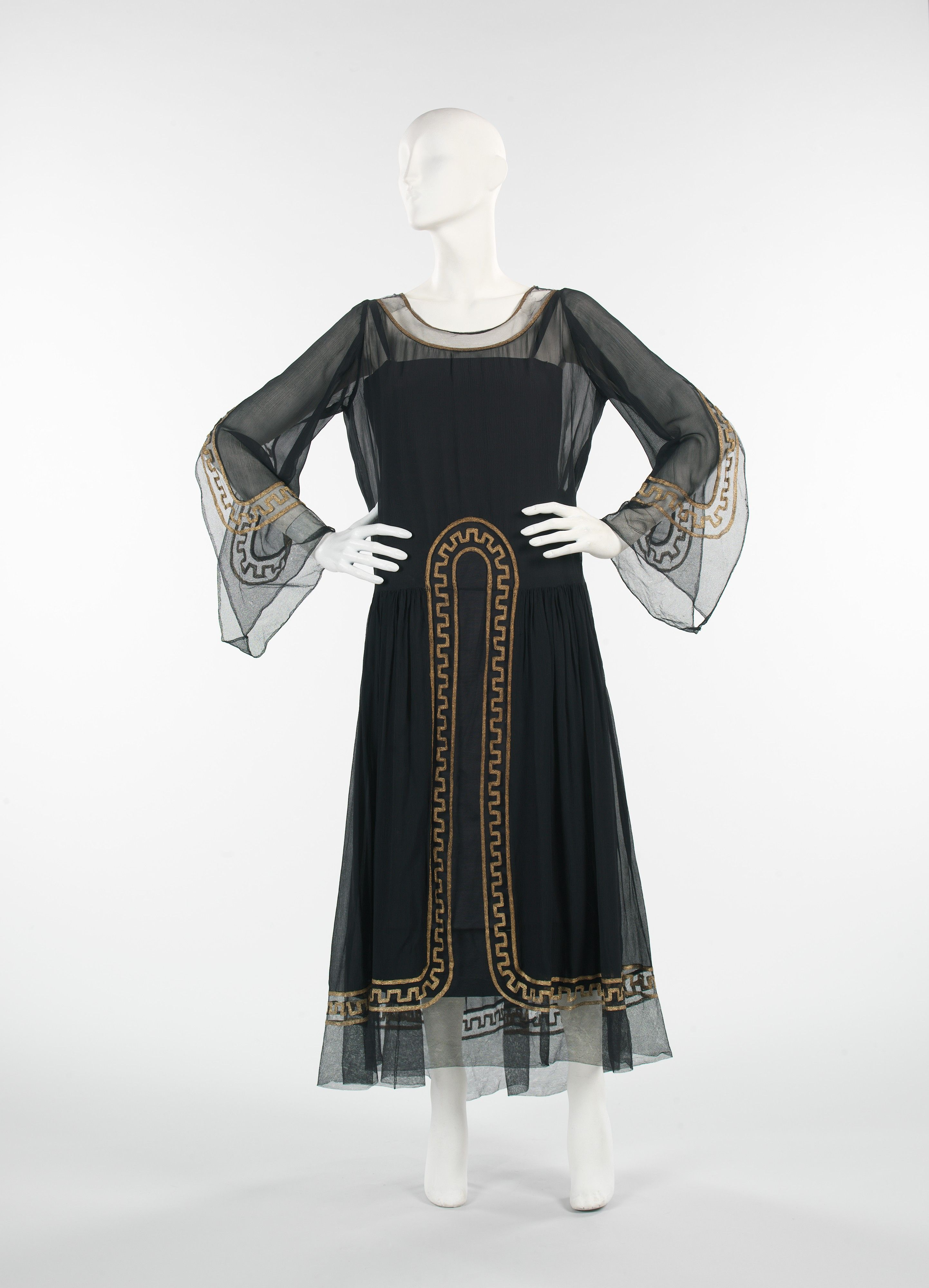 """Evening Dress, House of Lanvin (French, founded 1889): 1925, French, silk/metal. """"...The basic silhouette on this Lanvin dress evokes religious robes worn by monks while the sheer textile makes it elegant and refined, trademarks of her work. In addition, the Greek key motif shows her knowledge and interest in incorporating classical design motifs in her fashions."""""""