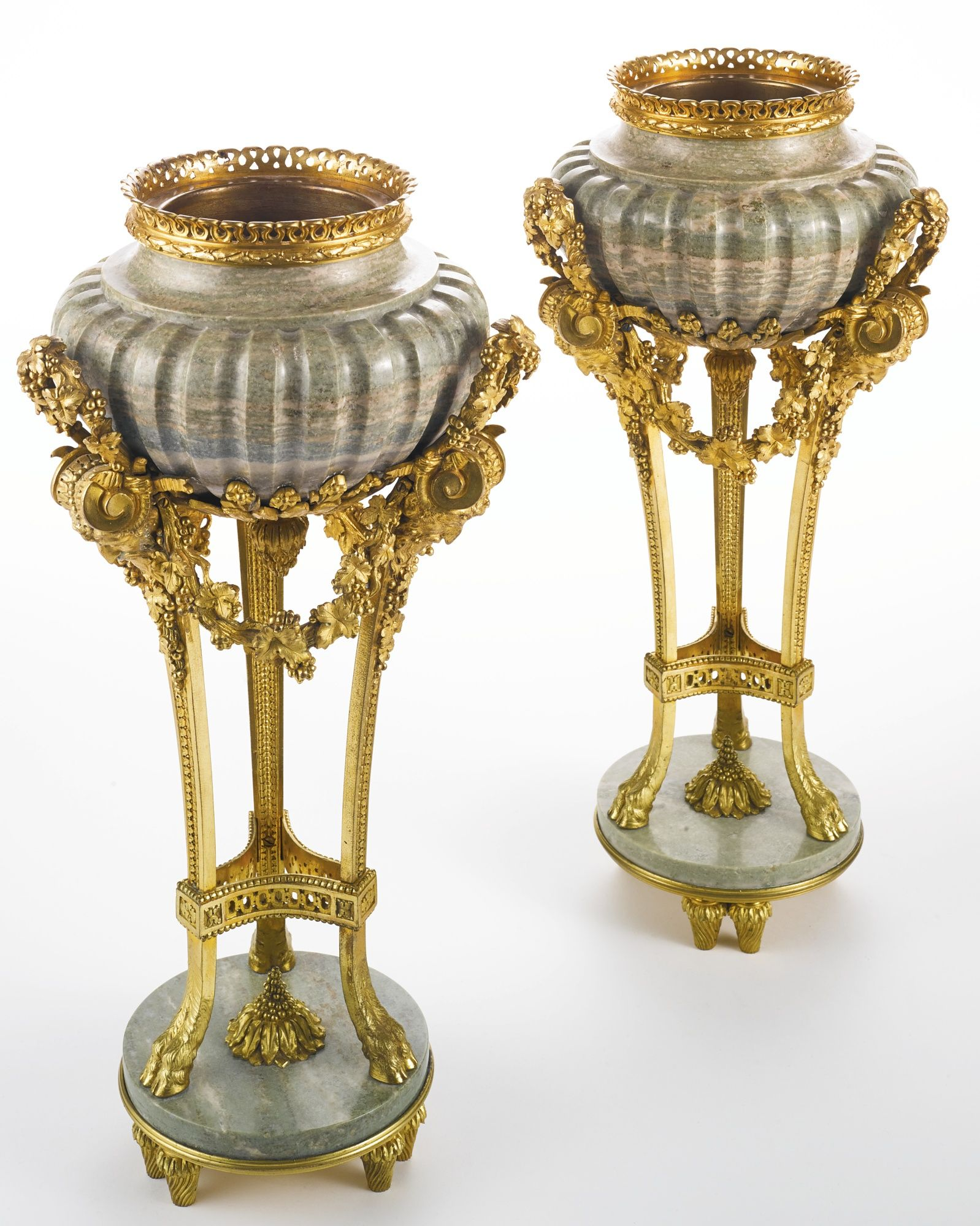 A PAIR OF LOUIS XVI STYLE GILT BRONZE-MOUNTED IRISH CONNEMARA MARBLE URNS PARIS, LATE 19TH CENTURY, AFTER THE CELEBRATED MODEL BY PIERRE GOUTHIÈRE