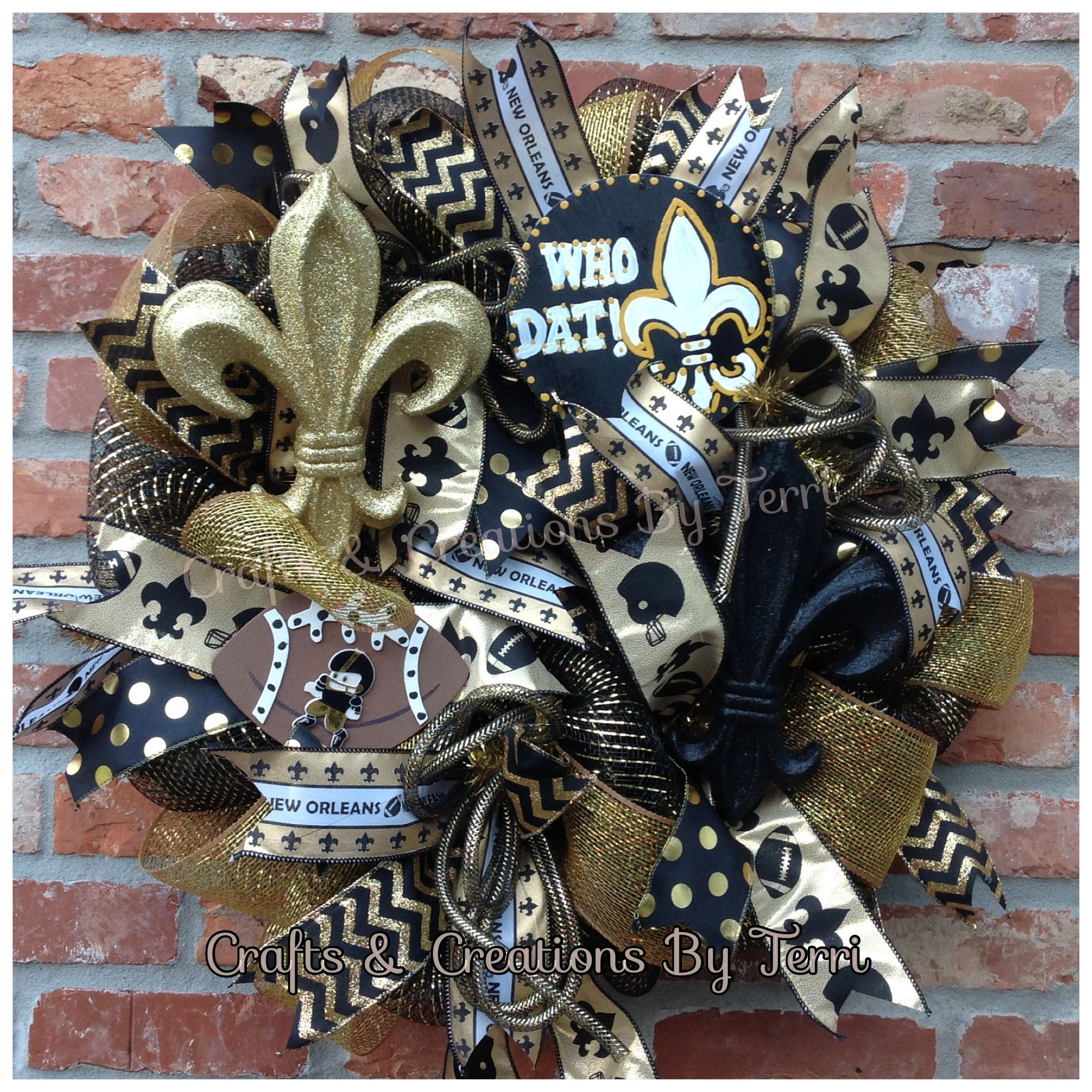 New Orleans Saints football wreath. Follow Created By Terri/Crafts & Creations By Terri www.facebook.com/CraftsandCreationsByTerri  www.etsy.com/shop/CreatedByTerri Instagram @ CreatedByTerri  Twitter @ designsbyterri #craftsandcreationsbyterri #createdbyterri #etsy #doorwreaths #football #saints #neworleans