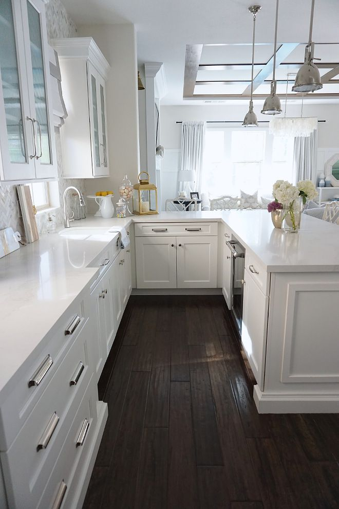 Kitchen Peninsula with white quartz countertop and dark ... on Maple Kitchen Cabinets With Dark Wood Floors Dark Countertops  id=91850