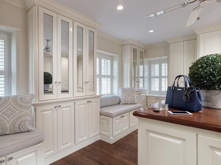 Chic Walk In Closet Features A Ceiling Fan Over White Island Topped