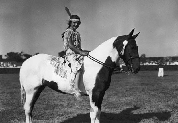 Jacqueline Bouvier, age 10, daughter of Mr and Mrs John V Bouvier III, in her prize-winning American Indian costume at a horse show at the East Hampton Riding Club, Long Island, New York. Young Jacqueline, who is seen here riding her piebald pony, 'Dance Step,' spent the 1939 summer season at the home of her parents.