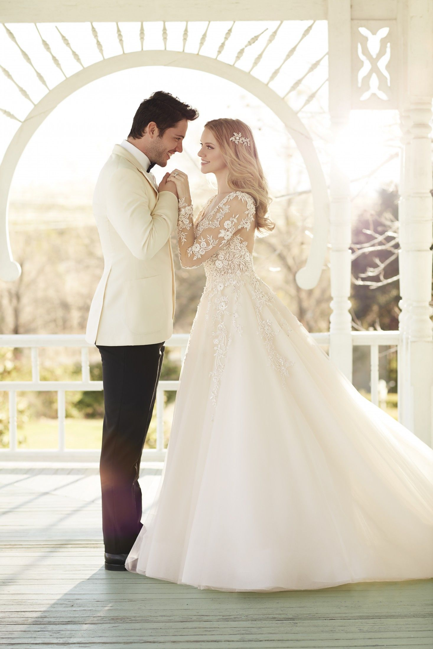 18c05a3d4f This designer wedding dress from Martina Liana features illusion lace  sleeves
