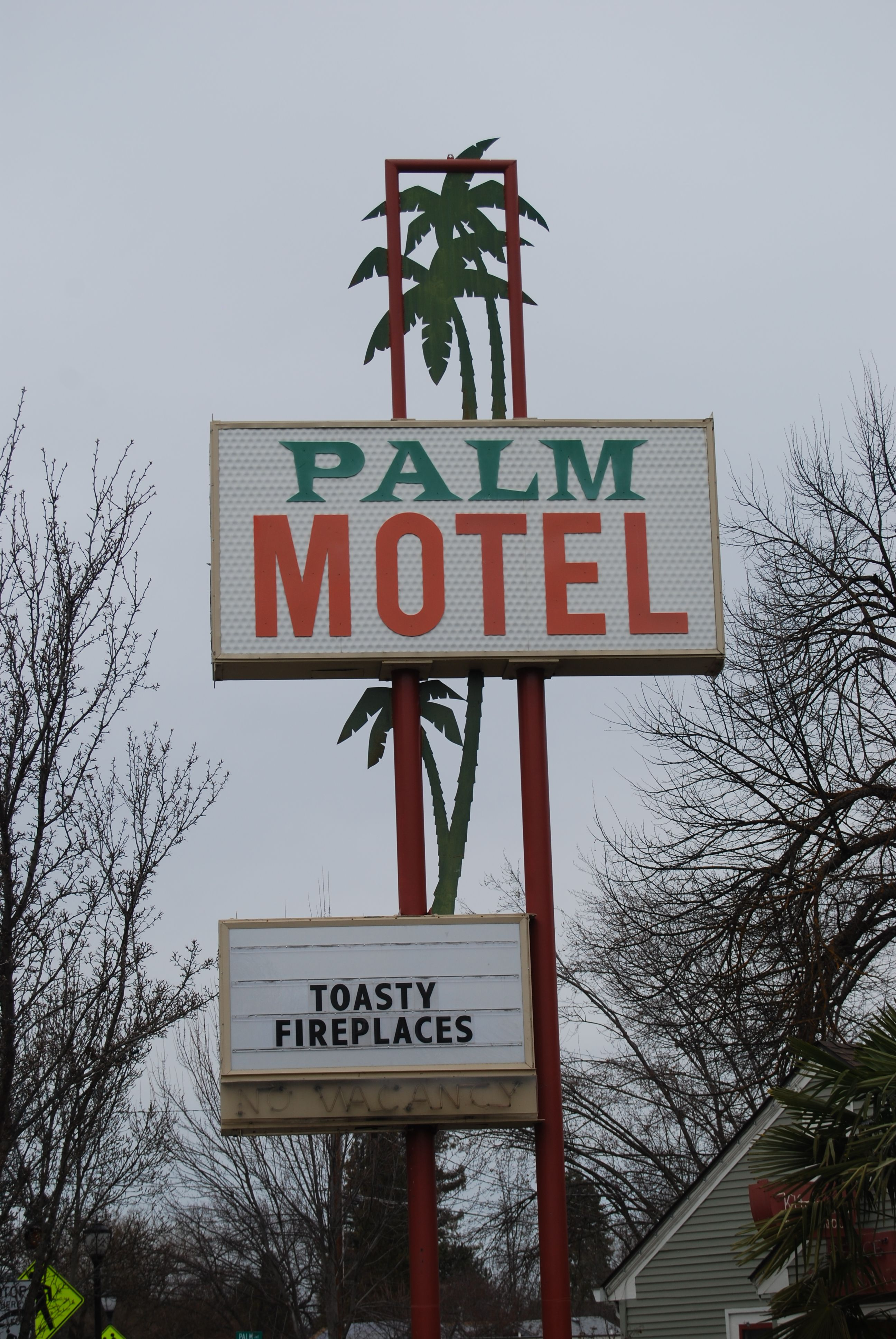 The palm motel at 1065 siskiyou blvd in ashland oregon not neon but the metal cutouts are so cool there is neon on the office building
