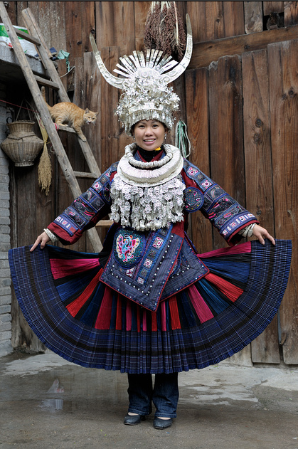 """Miao - Guizhoo - China. """"Keepers of silver"""". With a population of more than seven million, the Miao people form one of the largest ethnic minorities in southwest China. The Miao ethnic group's silver ornaments are second to none, both in terms of quantity and variety. Miao women's festive attire includes a variety of silver decorations, weighing as much as 15 kilos!"""