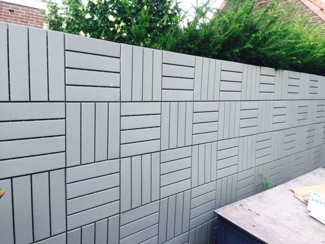 Ikea runnen floor decking tiles work great as a wall fence for Garden decking fencing