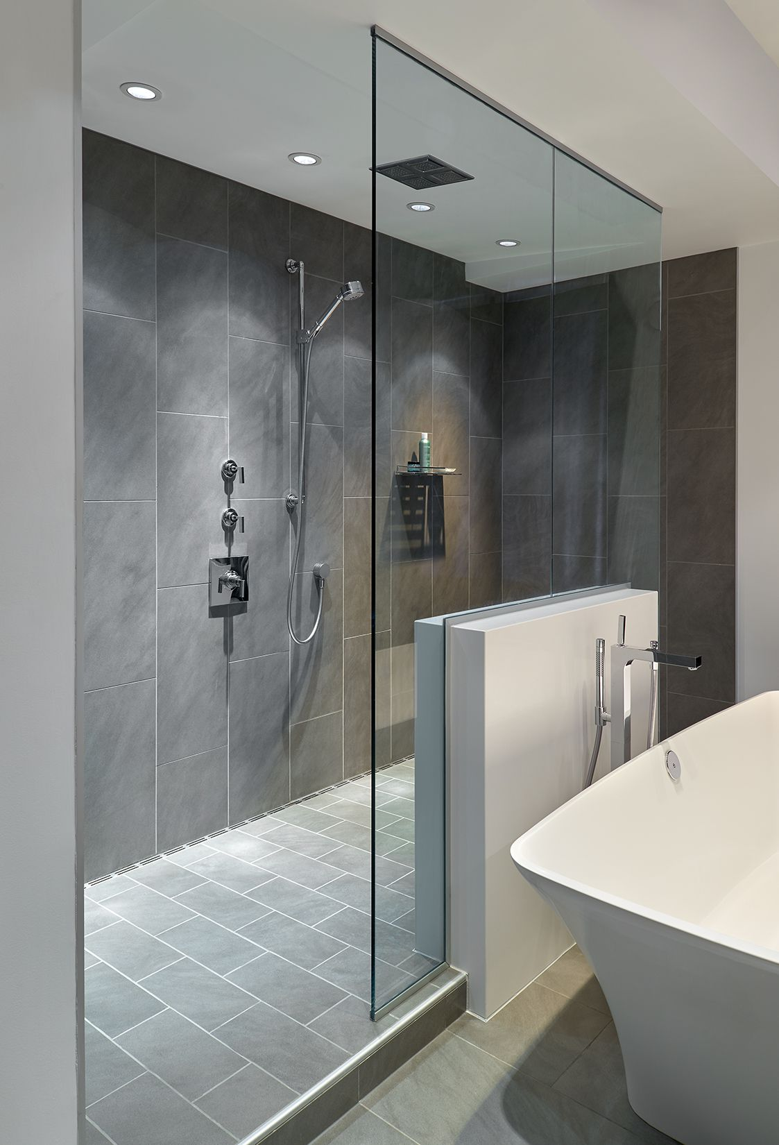 Large Walk In Doorless Shower With Gray Slate Tiles And A Floating Glass Wall Creates A Gorgeous Modern Look Bathroom Remodel Shower Shower Remodel Shower Tile