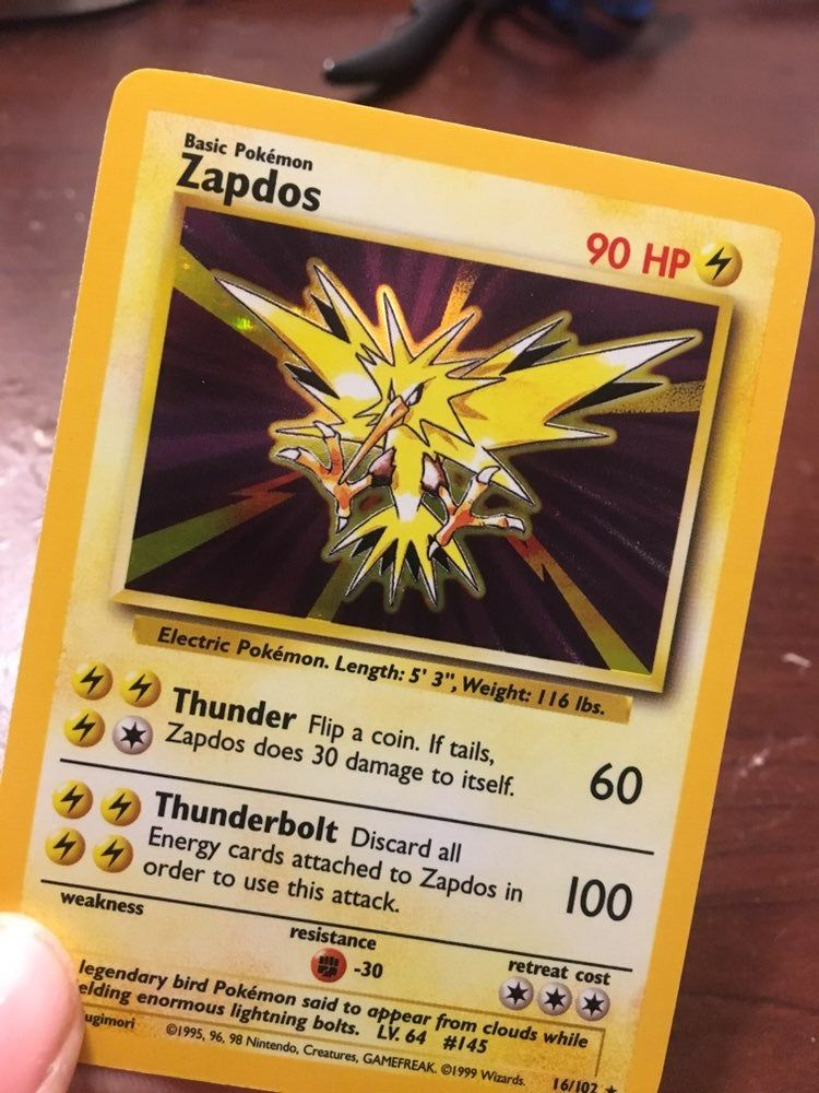 Holo Zapdos card from the base set. In good condition