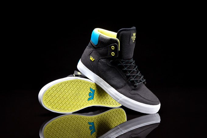 The Vaider in black Raptor TUF, black TUF, with fluorescent yellow and turquoise accents.