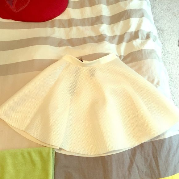 Skater skirt never worn! Cream colored skater skirt, goes perfect with heels or chuck tailors. The back has a zipper on it that accentuates your waistline. Rue 21 Skirts Circle & Skater