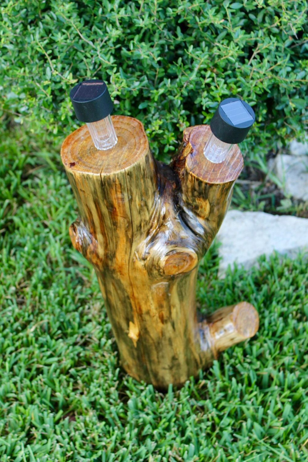tree stump tree log with outdoor solar lights by