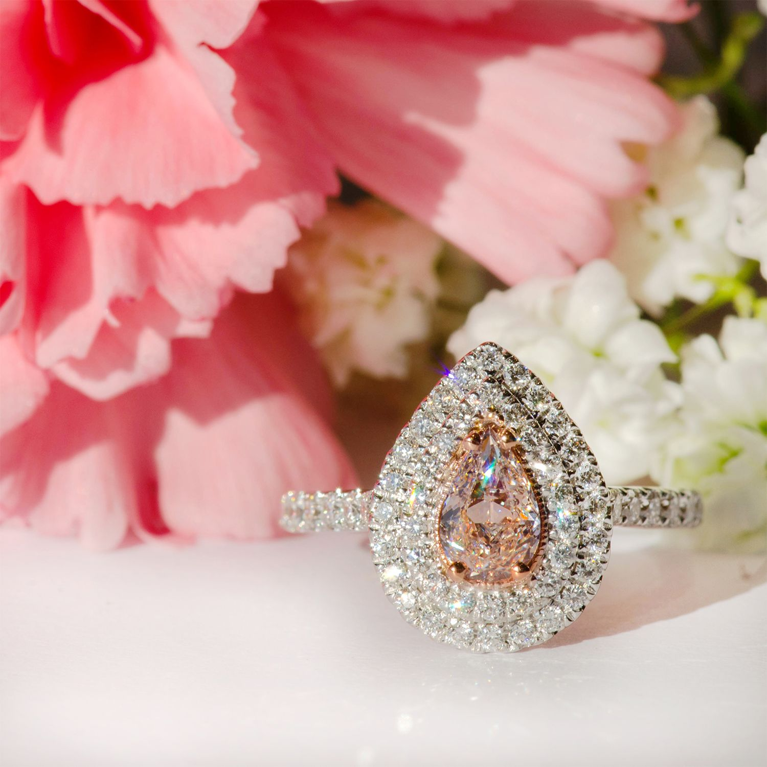 We are completely obsessed with this fancy pink pear diamond ring ...