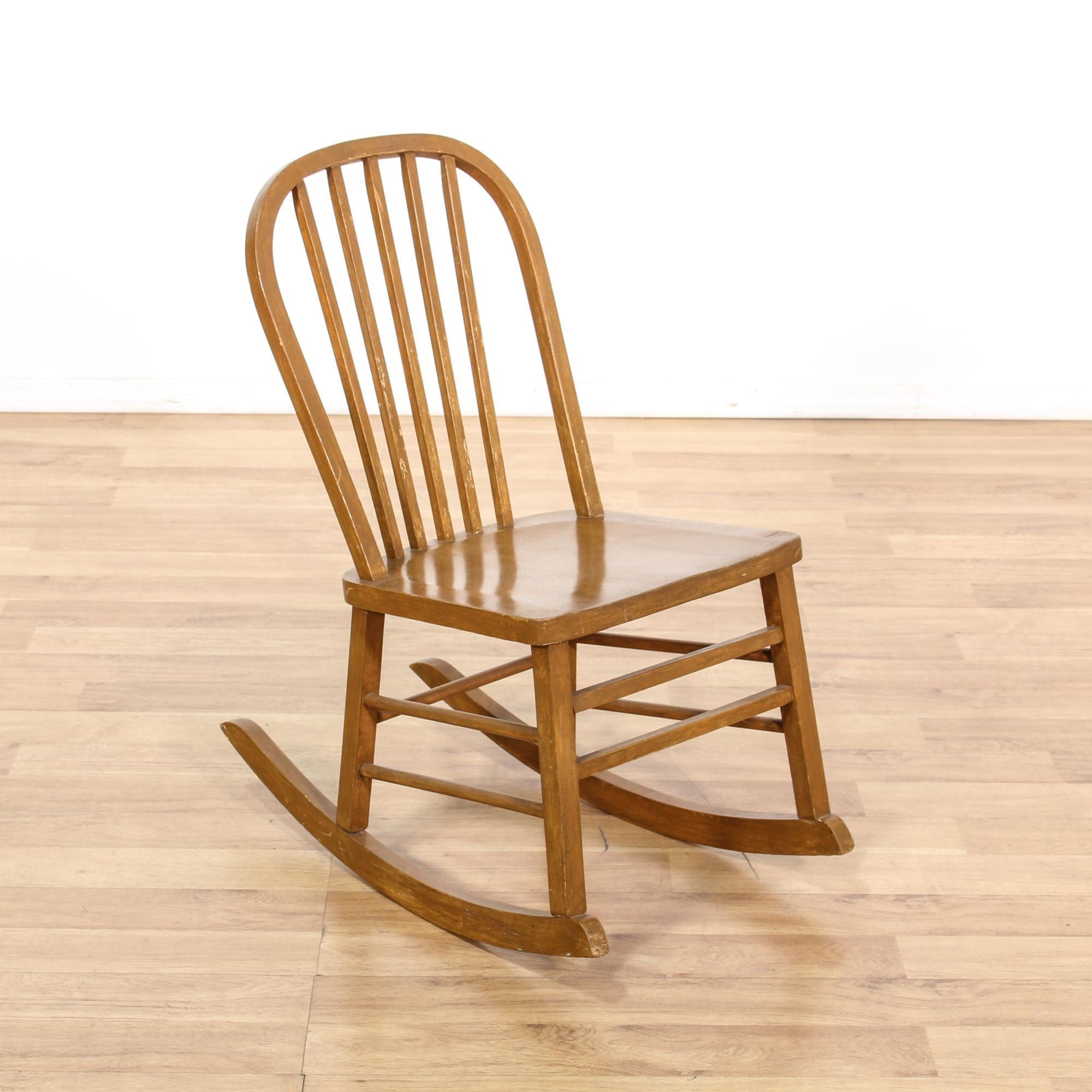 This Childu0027s Rocking Chair Is Featured In A Solid Wood With A Distressed  Maple Finish.