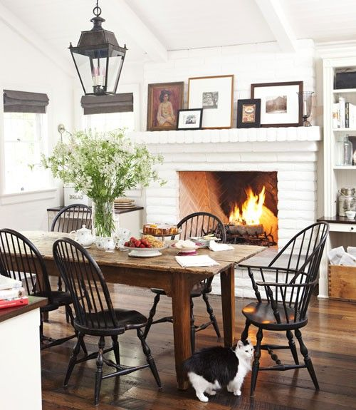 Cozy Dining Room With White Brick Fireplace