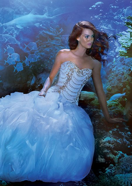 A woman wearing the Ariel wedding gown from the Alfred Angelo Bridal ...