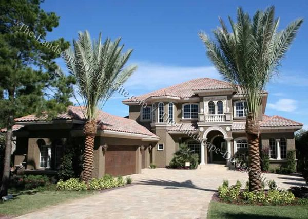 A Paver Driveway Front Entry With A Tropical Influence