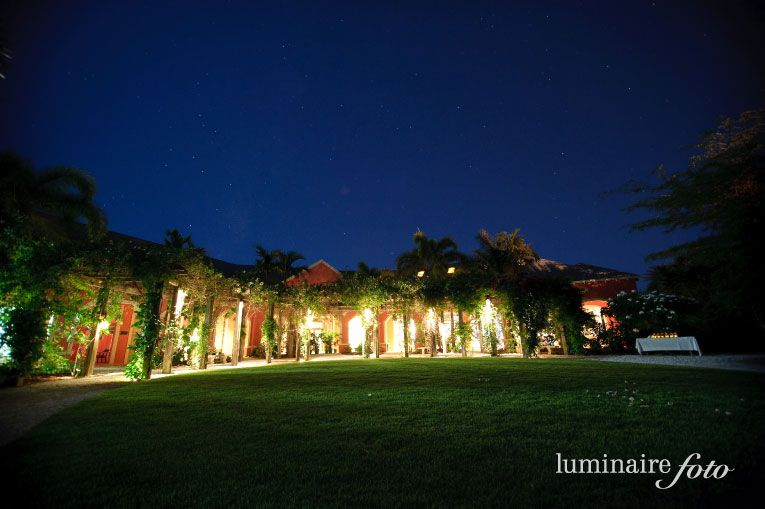 Beautifully lit Windstar Garden Room at night at Naples