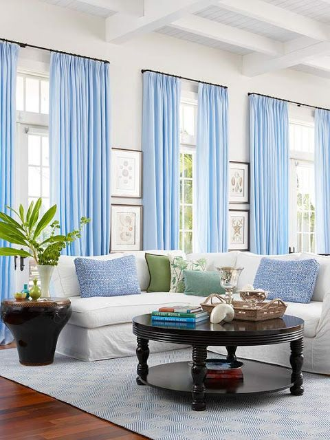 Gorgeous Stark White Walls With Blue Accents In A Living Space Prepossessing Blue Curtain Designs Living Room Design Inspiration