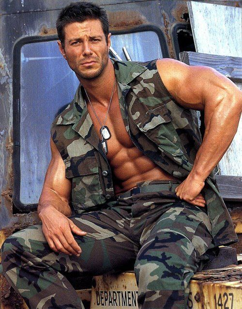 Phrase magnificent Muscle men in military uniform what?
