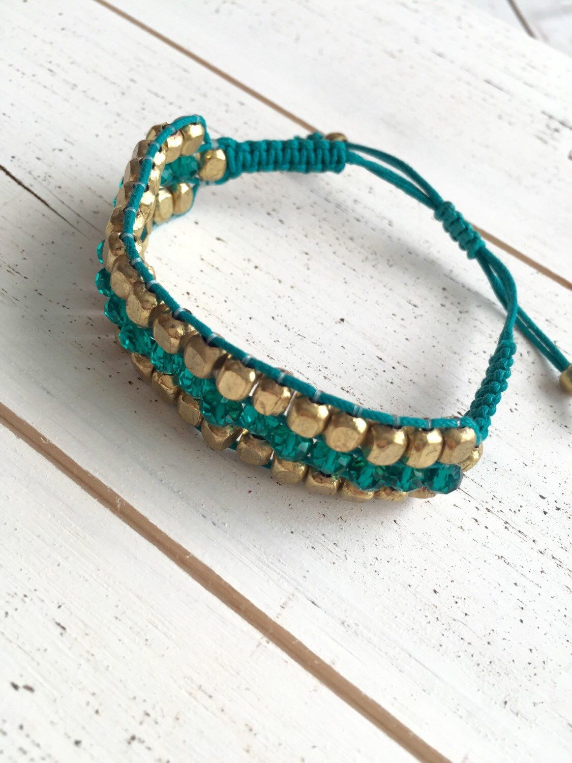 A personal favorite from my Etsy shop https://www.etsy.com/listing/275527688/beautiful-teal-and-golden-beaded