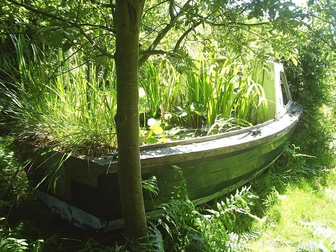 I think this is funny turning an old fiberglass boat for Fiberglass garden ponds