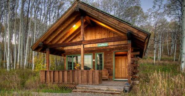 Everyone Loves the Spacious Living Room of This Lovely Log Cabin