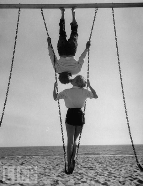 Allan Grant - Swingers, 1955  Acrobat and actor, Russ Tamblyn (Top) on the beach with movie actress Venetia Stevenson